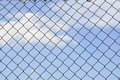 Sky behind the fence. The concept of freedom security loneliness imprisonmentrefugee Royalty Free Stock Photo