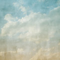 Sky and clouds with a yellow to blue gradient image has a textured paper overlay grain pattern visible at Stock Images