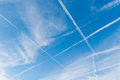 Sky with crossing vapor trails Royalty Free Stock Photo
