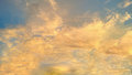 The sky with fluffy clouds and bright yellow sunshine