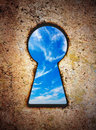 Sky in keyhole on old wall Royalty Free Stock Image