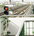 A sky modern train arrives -Bangkok red stop Royalty Free Stock Photo
