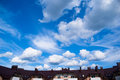 The sky over the house blue with clouds Royalty Free Stock Photos