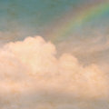 Sky rainbow clouds on a textured, vintage paper background with Royalty Free Stock Photo