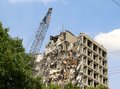 A sky scrapper building being demolished in the center of downtown Stock Images