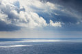 Sky and sea cloudy blue above a blue surface of the Royalty Free Stock Image