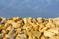 Sky and several yellow rocks. Backgroung with clear blue sky meeting multitude of yellow rocks on daytime.. Royalty Free Stock Photo