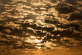 Sky at sunset golden waves of clouds during the Royalty Free Stock Photography
