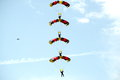 Skydaiving.Dome acrobatics - the whatnot from four parachutists. Royalty Free Stock Photo