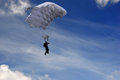 Skydiver in the sky moving down high speed just before landing background with blue with clouds Stock Photo