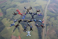 Skydiving big group formation teamwork this is necessary to make a beautiful and perfect figure in concentration focus and Royalty Free Stock Photo