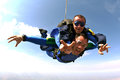 Skydiving tandem jump hapiness two friends with a parachute they smile and are happy brazil Stock Image