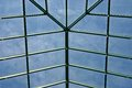 Skylight blue sky shows through the metal framework of a Stock Photography