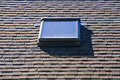Skylight in roof a on an asphalt shingled Stock Images