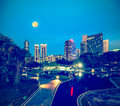Skyline of central district of kuala lumpur vintage retro hipster style travel image business in night malaysia Stock Photo
