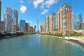Skyline of chicago illinois along the chicago river city in against a bright blue sky with white clouds Stock Photo