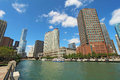 Skyline of chicago illinois along the chicago river tour boats and city in against a bright blue sky with white clouds Stock Images