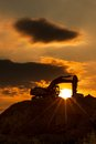 Skyline excavator with colored sunset Stock Photography