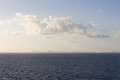 Skyline on the horizon distant city at sea Stock Photos