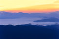 Skyline with mist and mountain at Doi Pha Hom Pok, the second highest mountain in Thailand, Chiang Mai, Thailand. Royalty Free Stock Photo