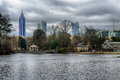 Skyline and reflections of midtown Atlanta, Georgia in Lake Meer Royalty Free Stock Photo