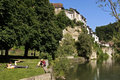 Skyline of Swiss city Fribourg and sunbathers Royalty Free Stock Photo