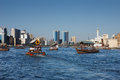 Skyline view of Dubai Creek with traditional boat Stock Photography