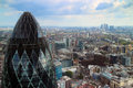 Skyline view of london with gherkin in the foreground panoramic over canary wharf and thames river taken on a cloudy summer day Royalty Free Stock Image