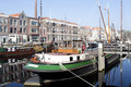 A skyline of vintage buildings and masts ships in the old district delfshaven in rotterdam netherlands Stock Photography