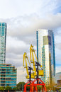 Skyscraper and cranes modern in puerto madero neighborhood of buenos aires with old colorful Royalty Free Stock Images