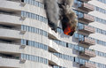 Skyscraper floor on fire blows out the windows in a tall Royalty Free Stock Images