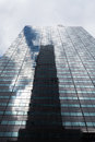 Skyscraper low angle view with reflections, New York City Royalty Free Stock Photo