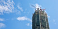 Skyscraper under construction the constuction in blue sky blackground Stock Photography