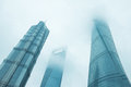 Skyscrapers reaching the clouds in financial district in shanghai from low angle Royalty Free Stock Photo
