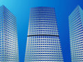 Skyscrapers three modern buildings over blue sky background Royalty Free Stock Photo