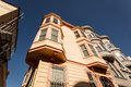 Skyward view of pretty bay windows on san francisco house corner row Royalty Free Stock Photography