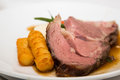 Slab of Prime Rib and Potato Puff Royalty Free Stock Photo
