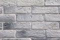 Slabs imitation bricks on wall closeup in sunny day Royalty Free Stock Photography