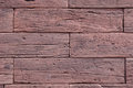 Slabs imitation red wood on wall closeup in sunny day Royalty Free Stock Photo