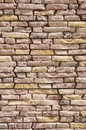 Slabs imitation stone on wall closeup in sunny day Royalty Free Stock Photography
