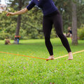 Slack line in the city park. Royalty Free Stock Photo