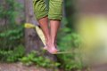 Slack line in the nature slacklining is a practice balance that typically uses nylon or polyester webbing tensioned between two Stock Image