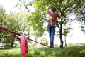 Slackline man practicing in the nature Royalty Free Stock Image