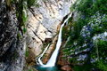 Slap Savica waterfall in Slovenia flows over mossy cliffs