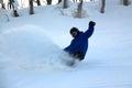 Slashing powder in the backcountry snowboarder mid backflip at hanazono jump japan niseko at its best Stock Image
