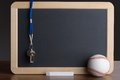 Slate with baseball chalk and whistle close up of Royalty Free Stock Photography