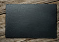 Slate over old wooden background Royalty Free Stock Photo