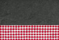 Slate plate with a checkered tablecloth red Royalty Free Stock Photography