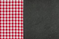 Slate plate with a red checkered tablecloth Royalty Free Stock Images