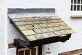 Slate roof a above a doorway Royalty Free Stock Images